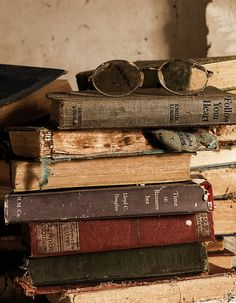 Oh, how I love old books. Never thought to display my grandmother's glasses with the books.
