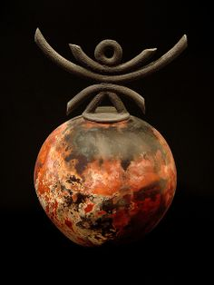 *Spyder by Jerry Rhodes - A wheel thrown vessel, Raku fired in a saggar with organic materials.