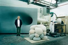 Anish Kapoor in his London studio, with unfinished works and a member of his team...