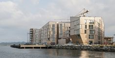"""Danish architecture from AART Architects - a residential area in Stavanger, Norway. """"The Waterfront"""" (Vandkanten) includes 125 flats, shops and cafes. It is praised as the largest wooden development. Architecture Images, Architecture Awards, Commercial Architecture, Futuristic Architecture, Amazing Architecture, Residential Building Design, Residential Architecture, Stavanger Norway, Scandinavian Architecture"""