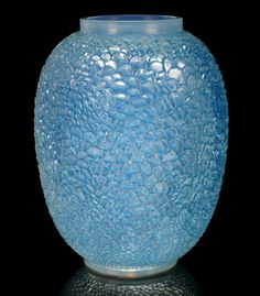 René Lalique  'Écailles' a Vase, design 1932  opalescent glass, heightened with blue staining  24.5cm high, etched 'R. Lalique France'