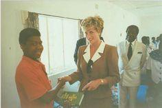 July 11, 1993: Princess Diana visiting an Old People's Home in the Chitiungwaiza Township, Zimbabwe.