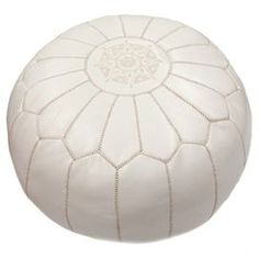 "Brimming with cosmopolitan appeal, this handcrafted leather pouf showcases embroidered Moroccan-inspired stitching.    Product: PoufConstruction Material: Leather and shredded foam fillColor: WhiteFeatures:    HandmadeMoroccan-inspired arch motifCan be used as an ottoman or extra seating Dimensions: 14"" H x 20"" Diameter"