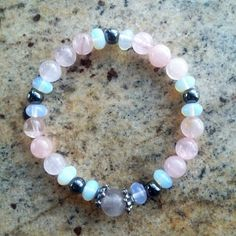 VALENTINES DAY SALE Stretchy healing stone bracelet with fluorite, hematite, rose quartz and opalite stones. Has slight drape on average sized wrist To see more of our healing stone jewelry, please click here: https://www.etsy.com/shop/CoyoteWindCreations?section_id=19979661 To see our dreamcatcher jewelry, please click here: https://www.etsy.com/shop/CoyoteWindCreations?section_id=19989564 To go back to our main storefront and browse ...