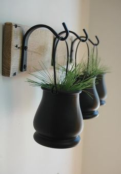 Black Pot Trio with Wrought Iron hooks on wood board for unique wall decor, home decor, bedroom deco Black Pot Trio with Wrought Iron hooks on by PineknobsAndCrickets Wrought Iron Decor, Iron Wall Decor, Unique Wall Decor, House Plants Decor, Plant Decor, Metal Pergola, Pergola Shade, Pergola Attached To House, Iron Work