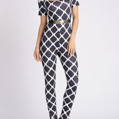 Printed Fitted U Neck Jumpsuit  $50.00    Material: Polyester  Fit Type: Skinny  Pattern Type: Plaid  Style: Fashion  Season: Fall,Spring,Winter  Elasticity: Elastic  With Belt: Yes  Weight: 0.370kg  Package Contents: 1 x Jumpsuit 1 x Belt