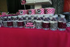 Another great time-saving idea from Cairo Custom Events. Duct tape wrapped water bottles allowing them to stay cold by submerging them in water without soaking regular paper bottle wrappers. #HotPink and #ZebraPrint #Barbie #Party
