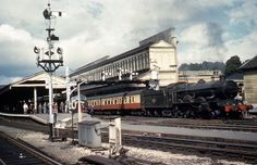 Castle 5055 Earl of Eldon leaving Exeter St. Davids with a Swansea to Penzance train in August 1961.