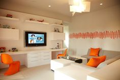 Modern playroom design with gray sectional sofa, orange pillows, white . Modern Boys Rooms, Modern Playroom, Playroom Design, Modern Kids, Playroom Ideas, Modern Bedroom, Boys Room Decor, Boy Room, Kids Room