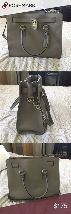 Michael Kors Hamilton Tote in Grey Leather tote with top two handles and leather shoulder strap. Interior zip pocket, interior cell phone pocket. Two interior pouch pockets. Key fob pockets. Magnetic Fastening. Michael Kors Bags Totes