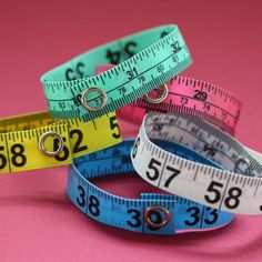 Five Pack of Tape Measure Bracelets in Various by undoneclothing, $13.00