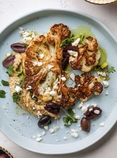 This roasted cauliflower with hummus olives and feta is super flavorful and a wonderful meal side dish or snack. Flavorful roasted cauliflower creamy hummus briney olives and tangy feta come together to make a major taste explosion. I howsweeteats. Cauliflower Hummus, Roasted Cauliflower, Cauliflower Steaks, Vegetarian Recipes, Cooking Recipes, Healthy Recipes, Recipes With Hummus, Eat Healthy, Hummus Flavors