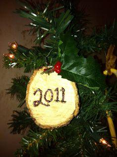 tree stub converted into a wood burned ornament