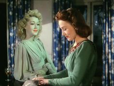 Kay Hammond as the ghost and Constance Cummings as Ruth Condomine in Noel Coward's 'Blithe Spirit' directed by David Lean, 1945