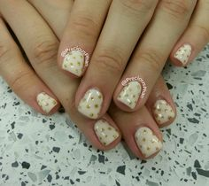 White and gold nails with polka-dot nails