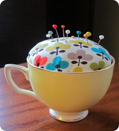 Lots of cute pincushion tutorials; upcycle 2nd-hand cup and fabric here.