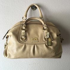 Coach satchel with shoulder strap. This is a lovely bag. I only used it for special occasions because I couldn't stand the idea of dirt getting on it or that wonderful lining. You'll envoy it for sure. Coach Bags Satchels