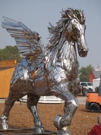 Pegasus sculpture by Sean Guerrero statue; welded together out of chrome bumpers from old automobiles. Commissioned by actor Jack Palance in 1990. Sold at an estate auction in 2007 for 40,000. Now on display at Madland Toyota-Lift Inc., Bakersfield, California.
