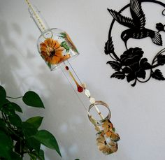 Lighted Wine Bottle Wind Chime, Yard Art, Patio Lighting, Recycled Wine  Bottle, Turquoise And Lavender Flowers, Dark Amber Glass, Wind Chime | Yard  Art, ...