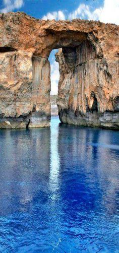 The Azure window is a limestone natural arch on the Maltese island of Gozo. It is situated near Dwejra Bay on the Inland Sea, Malta. Places Around The World, Travel Around The World, Around The Worlds, Places To Travel, Places To See, Beautiful World, Beautiful Places, Natural Wonders, Belle Photo