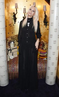 Poppy Delevingne wears a black Victorian maxi dress with a statement necklace