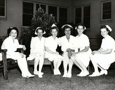 Nurses pose on the lawn of the Permanente Oakland hospital during World War II