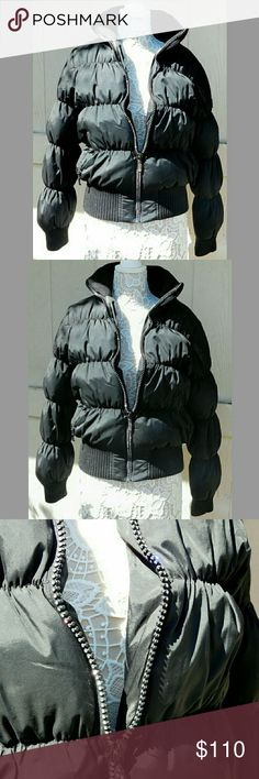 "JOHN CARUANA RHINESTONE ZIPPER DOWN JACKET JOHN CARUANA RHINESTONE ZIPPER DOWN JACKET  Pre-Loved/RN# 79745/Style# 33186 SZ M THIS IS SOOOOOOO Warm! Rhinestone Lined Front Zipper, Elastic Ribbed Collar & Cuffs, Side Zippered Pockets, Inside Zippered Slant Pocket JC is Known for Great Quality!  SHELL 65% Nylon   35% Polyester LINING 100% Polyester  FILLING 80% Down   20% Feather  Approx Meas; Pit to Pit 20"" Sleeve   19"" Back Neck to Hem   26""  Meas R Approx & Can be Interpreted Differently on…"