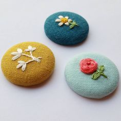 I dusted off my old button-making kit last weekend and made these. I'd forgotten how fun it is to make fabric buttons! 🔨💪 I attached an… Embroidery Works, Creative Embroidery, Learn Embroidery, Hand Embroidery Stitches, Embroidery Jewelry, Ribbon Embroidery, Embroidery Designs, Fabric Brooch, Textile Jewelry