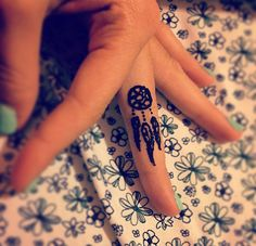 Henna dream catcher tattoo on middle finger