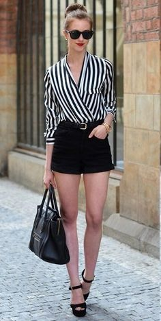 Vertical stripe crossover blouse with black shorts. street chic.
