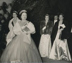 Queen Elizabeth, in the pre-alteration Greville tiara, daughter Margaret in the scroll and two ladies in waiting