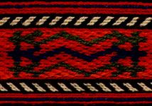 Motifs from a central North Bulgarian woman's belt. This belt wraps several times around the waist, and has motifs separated by blank spaces along its length. The diversity of pattern is typical of this genre of cardwoven belts. The ends of festive belts have elaborate warp-wrapping, in stylized geometric motifs. Typically the wearer would make sure that the decorated end would be tucked so that it fell hanging down over her hip.s
