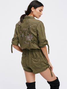 Fine and Fluid Embroidered One Piece   So soft military-inspired one piece featuring a femme update with gorgeous garden embroidery on the back. Front has a zipper closure with an effortless drawstring at the waist for the perfect fit. Six pocket design. Ties at the sleeves create a lived-in cuffed look.