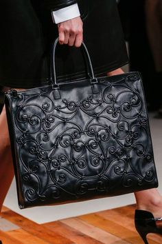 Fall 2013 Valentino - the designs on this bag evoke celtic patterning - as is on the Battersea Shield and many other pieces from even earlier.