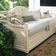 """Enjoy a cozy afternoon nap or host overnight guests with this stylish daybed, featuring louvered detailing and 2 under-bed drawers.   Product: DaybedConstruction Material: Cherry solids and veneersColor: LinenFeatures: Part of the Paula Deen Home Collection Louvered detailingTwo drawers for under-bed storageDimensions: 47"""" H x 81"""" W x 42"""" D  Note: Fits most twin mattresses. Accent pillows, linens and mattress are not included and are pictured for illustration purposes only.  Assembly: ..."""