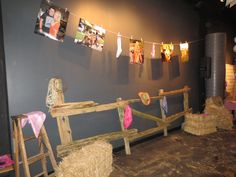 laundry line with photos, buy some wood and build a fence hang some barbwire on end , hay bails