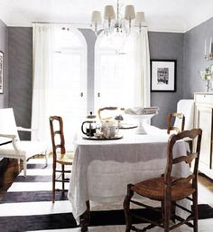 Cool gray walls (Benjamin Moore Sweatshirt), graphic black and white rug, crisp white drapery, beautiful doors leading out