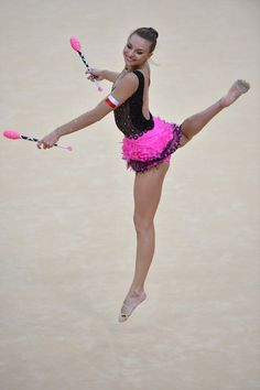 Poland's Joanna Mitrosz performs her clubs program during the individual all-around qualifications of the rythmic gymnastics event of the London Olympic Games on August 10, 2012 at Wembley arena in London.