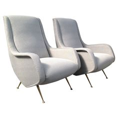 Lovely Pair of Armchairs Attribuited to ISA | From a unique collection of antique and modern armchairs at https://www.1stdibs.com/furniture/seating/armchairs/