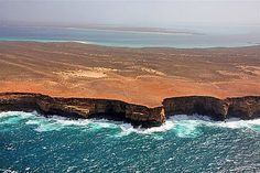 The Zuytdorp Cliffs are some of Australia's least known yet most spectacular cliffs, forming an almost unbroken arc between Steep Point and the township of Kalbarri, a distance of some 200 kilometres. The cliffs, rising ominously out of the Indian Ocean to heights of up to 200 metres, were named after the Dutch ship the Zuytdorp, wrecked against the base of the cliffs in 1712.
