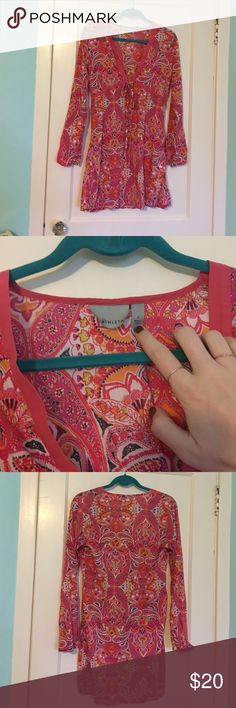 Athleta Dress Beautiful hot pink, orange, and many other colored paisley print. Can be worn as dress, tunic, bathing suit cover up. Excellent condition. Cotton, nylon, spandex. Athleta Dresses