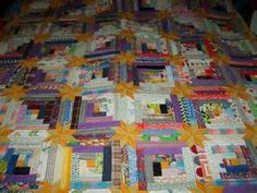 Colorado Log Cabin, designed by Judy Martin. The pattern appeared in her book Scrap Quilts in 1985. This may be my most popular original design. Maker unknown.