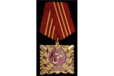 *Afghanistan, Order of the Saur Revolution, type 1 (1980-81?), in silver, gilt and red enamel (06