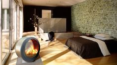 """Modern and relaxing, this room adheres to the """"colors found in nature"""" theory."""