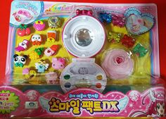 DX Smile pact dx Glitter Force SMILE PRECURE COMPACT Bandai Korea new. 2014,Bandai Korea new item. Includings : smile pact + 18 decals + bracelet. Various voices & Sounds & color lights. Language : Korean. Good collection gift toy.