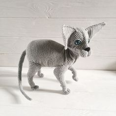 Amigurumi sphynx grey cat has all poseable paws and deep blue eyes.