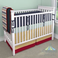 Crib bedding in Solid Navy Minky, Navy and Mint Aztec Stripe, Solid Scarlet Red Minky, Canyon Wall, Solid Red, Solid Navy, Mint and Gold Triangles. Created using the Nursery Designer® by Carousel Designs where you mix and match from hundreds of fabrics to create your own unique baby bedding. #carouseldesigns