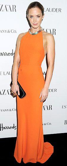Tangerine dream! Emily Blunt donned Alexander McQueen in London Oct. 31.