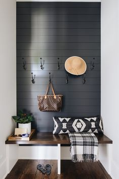 Mudroom bench designed in a floating oak feature with a black shiplap wall and iron hooks. Mudroom Cabinets, Mudroom Laundry Room, Black And White Interior, White Interior Design, White Shiplap Wall, Bench Designs, Ship Lap Walls, Black Walls, My Living Room