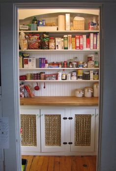 Great walk-in pantry. Cabinet space for small appliances and counter-top for prep and measuring.